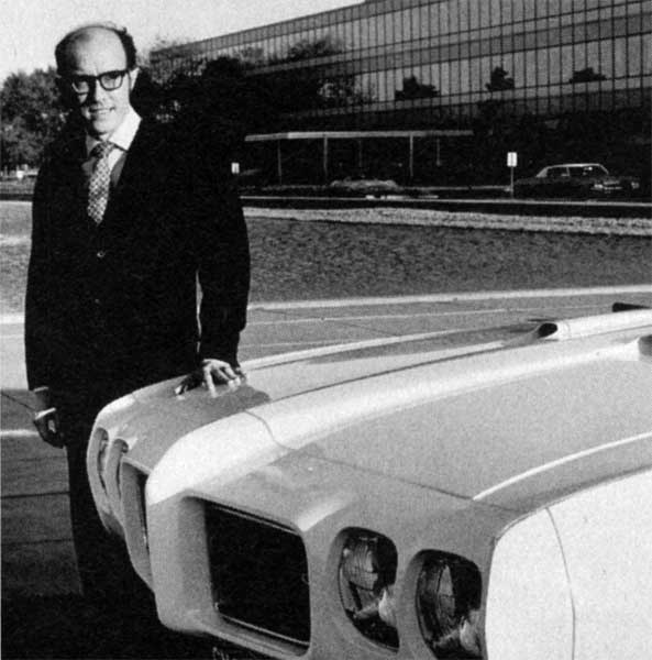 Bill Porter standing next to a 1970s GTO model GM Archives 4