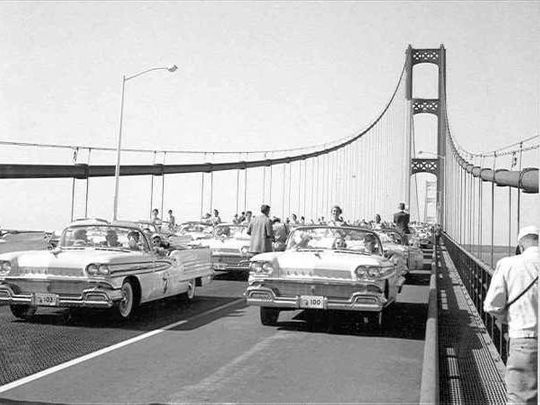 1958 Oldsmobile convertibles crossing during Opening Day on the Mackinac Bridge General Motors Hemmings 4