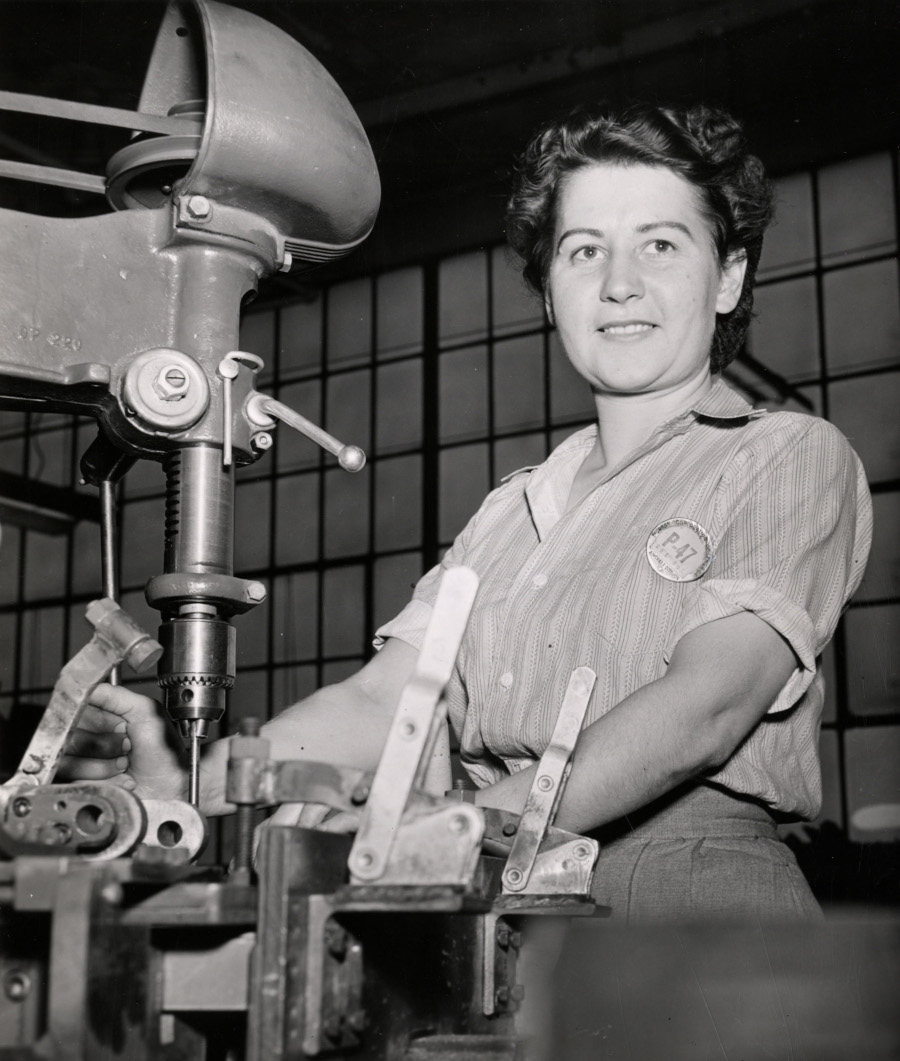 A woman works on operating machinery in the assembly of the P 47 Thunderbolt Detroit Public Library Digital Collection RESIZED 6