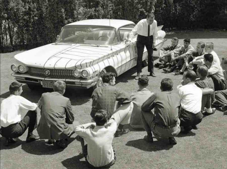 MacMinn teaching design students about the lines on a 1960 Buick Art Center College of Design RESIZED 2