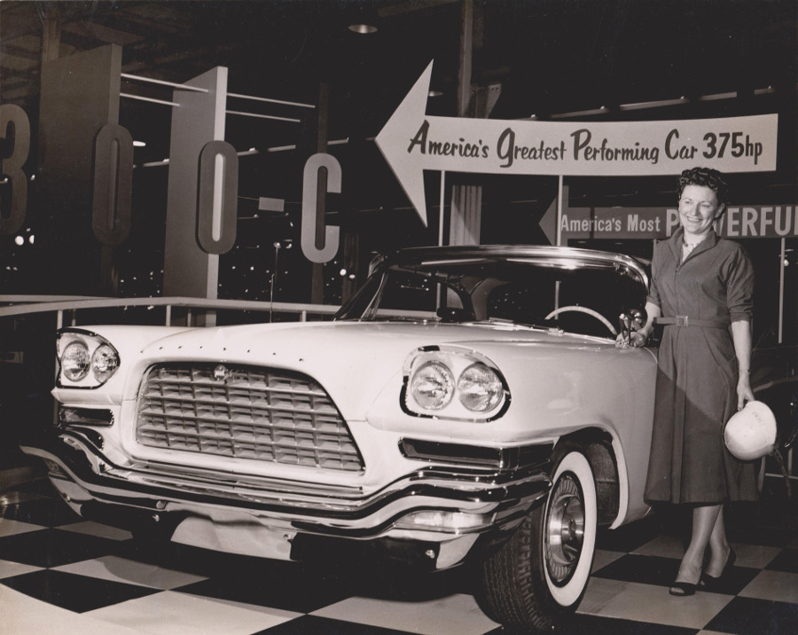 Vicki Wood standing with a 1957 Chrysler 300 Jalopy Journal 3 RESIZED
