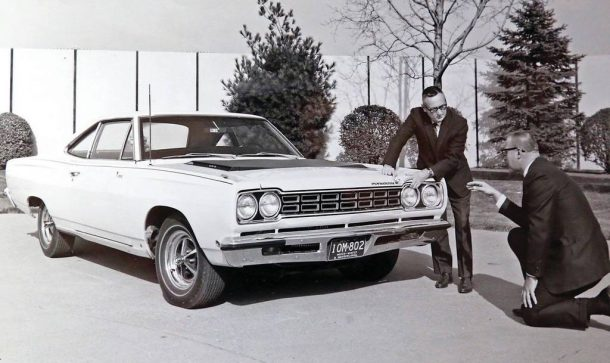 Jack Smith discussing the front end of the Plymouth Road Runner with Chrysler EVP Dick MacAdam 3