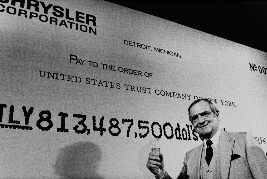 Resized Lee Iacocca with check paying off government loan to Chrysler Auto News 7